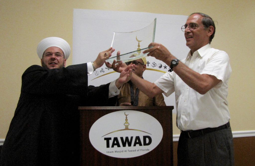 Imam Zaher and Ted hold the award together