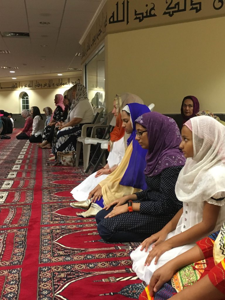 Women praying in the mosque. Non-Muslims were invited to join